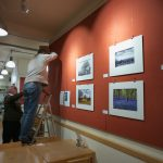Hanging the images in Café Red